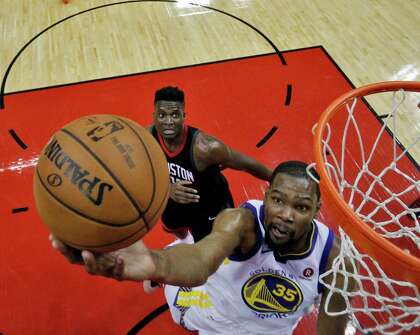 0c67f451650 Kevin Durant (35) drives to the basket with Clint Capela (15) in tow in the  first half as the Golden State Warriors played the Houston Rockets in Game  1 of ...