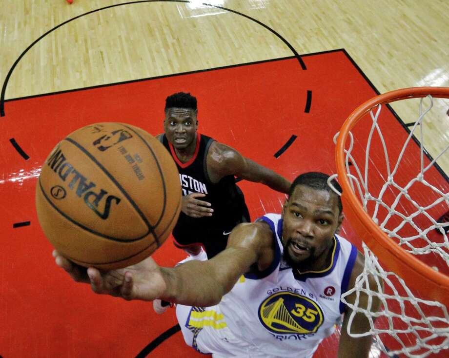 Kevin Durant (35) drives to the basket with Clint Capela (15) in tow in the first half as the Golden State Warriors played the Houston Rockets in Game 1 of the Western Conference Finals at Toyota Center in Houston, Texas., on Tuesday, May 15, 2018. Photo: Carlos Avila Gonzalez, The Chronicle / ONLINE_YES