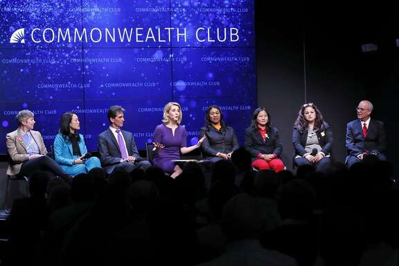 Amy Farah Weiss (left), Jane Kim, Mark Leno, moderator Melissa Caen, London Breed, Ellen Lee Zhou, Angela Alioto and Richie Greenberg during Monday's mayoral debate.