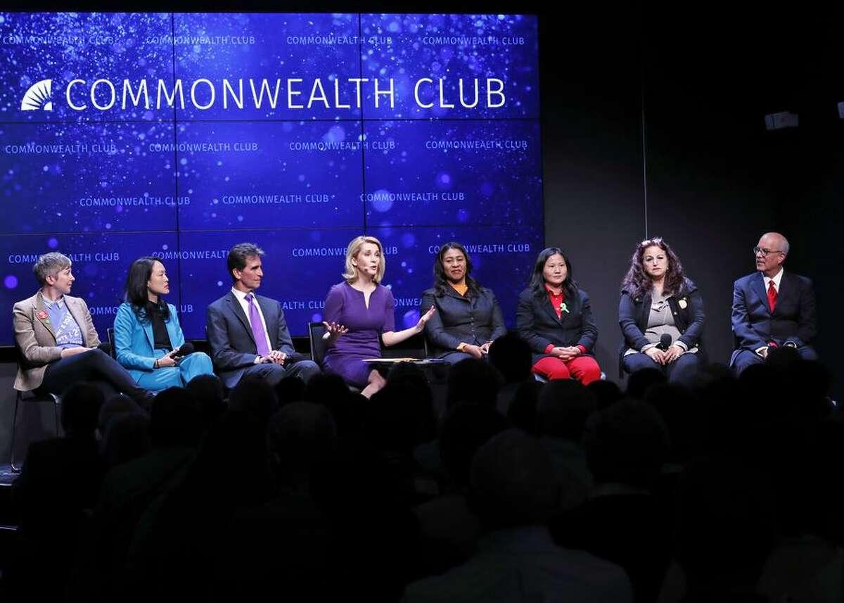 Amy Farah Weiss (left), Jane Kim, Mark Leno, moderator Melissa Caen, London Breed, Ellen Lee Zhou, Angela Alioto and Richie Greenberg during Monday's mayoral debate.