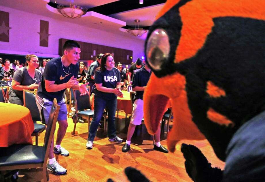 Rowdy and the head football coach Frank Wilson, to right of Rowdy,not in frame lead the students and families in a motivational chant he does with team before the start of practice at the final stop of the 2018 Rowdy's Roadshow on Monday, May 14, at the H-E-B Student Union. Photo: Ronald Cortes, For The San Antonio Express News / 2018 Ronald Cortes