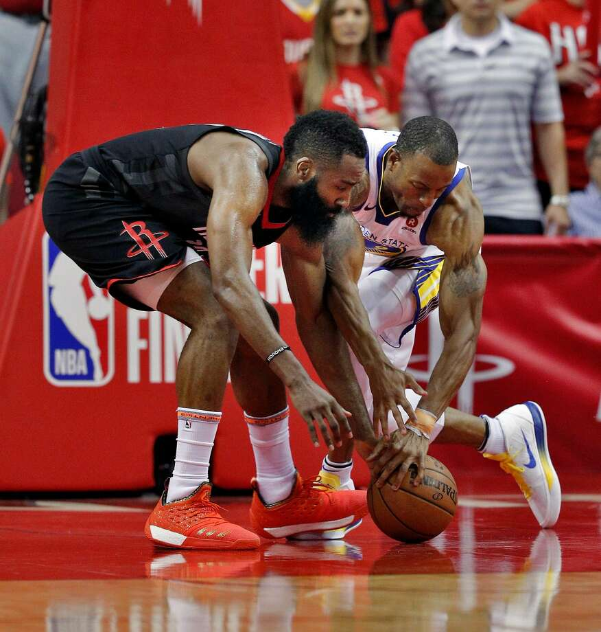 James Harden (left) of the Rockets and the Warriors' Andre Iguodala  battle for a loose ball in the second half. Harden had 41 points but also four turnovers. Photo: Carlos Avila Gonzalez / The Chronicle