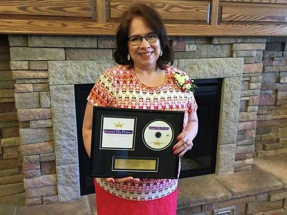 Gloria Everson poses with a copy of a recording of the Calvary Baptist Academy choirs. Everson will retire from her position as varsity and concert choir director at Calvary Baptist Academy on May 25. (Victoria Ritter/vritter@mdn.net)