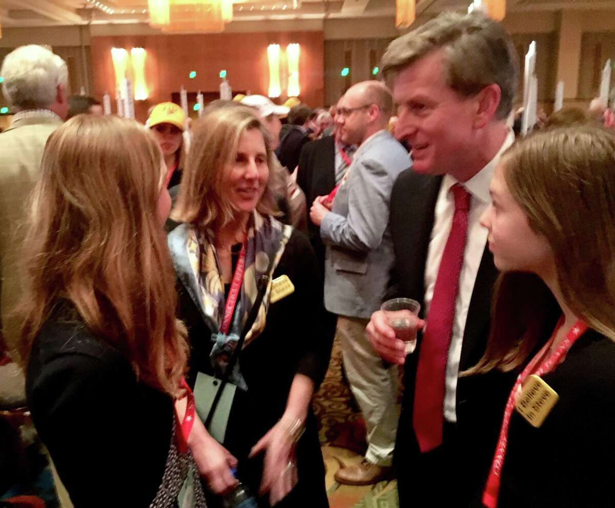 Steve Obsitnik with his wife, Suzanne, and daughters Kayden and Kira immediately after he won the right to a spot in the 2018 Republican primary for governor - and declared he will run.