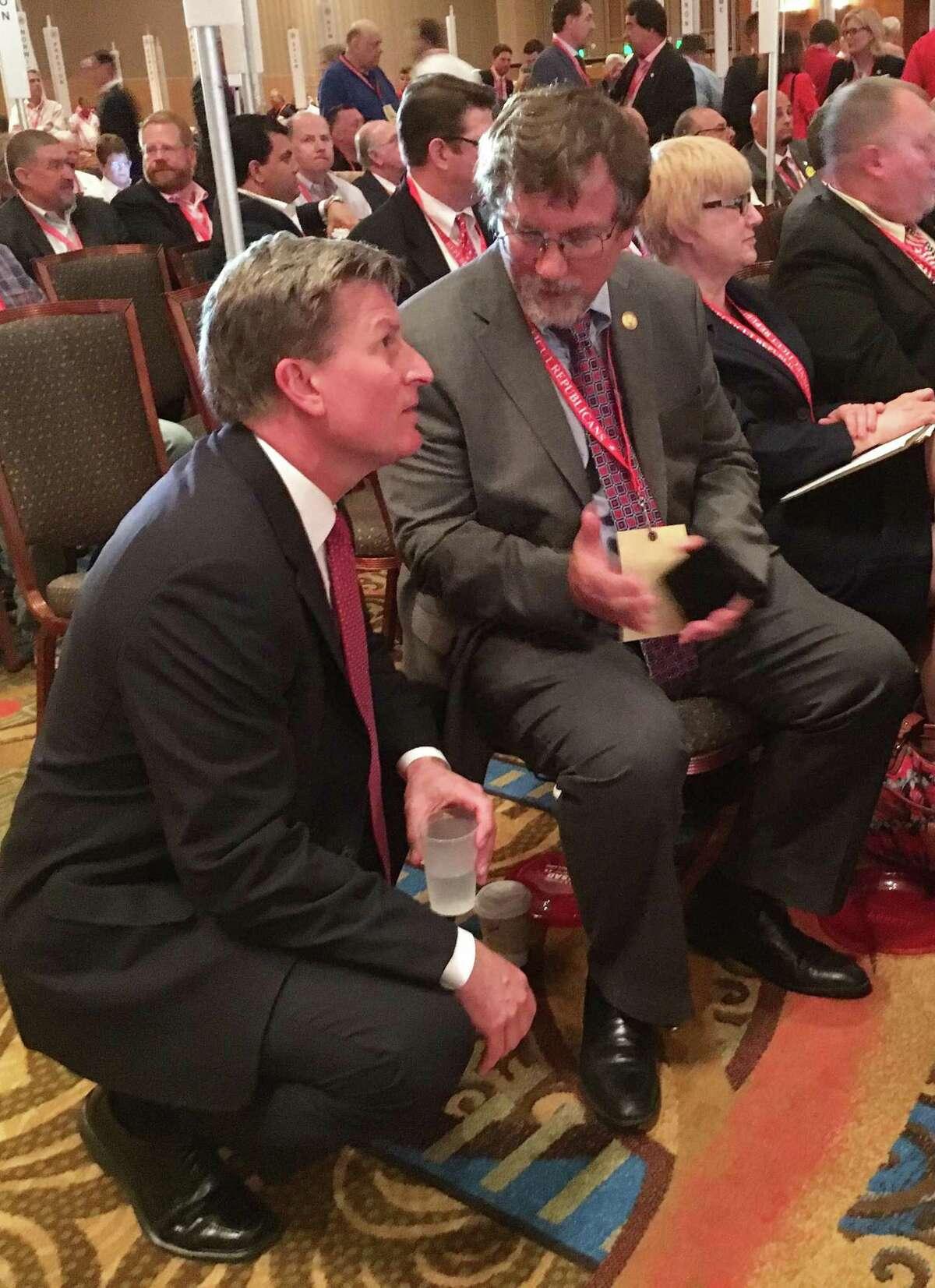 Republican gubernatorial candidate Steve Obsitnik at the state Republican convention Saturday speaks with Monroe delegate Jim Weinberg.