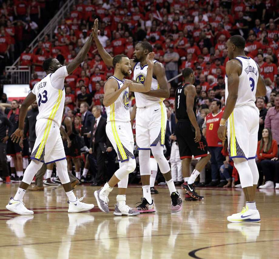 The Warriors Klay Thompson, Draymond Green, Stephen Curry, Kevin Durant, and Andre Iguodala high five in Game 1 of the Western Conference Finals in Houston, Texas., on Monday, May 14, 2018. Photo: Carlos Avila Gonzalez / The Chronicle / Carlos Avila Gonzalez - San Francisco Chronicle