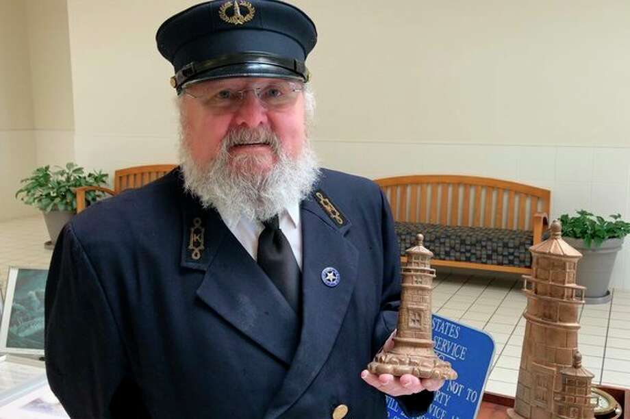 Lighthouse keeper reenactor Carl Jahnvisits the Saginaw River Marine Historical Society's pop-up maritime museum at Bay City Town CenterApril 21. (Photo provided/Rob Englund)