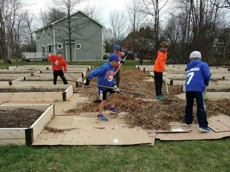 Children volunteer at the Chapel LanePresbyterian Church community garden. (Submitted photo)