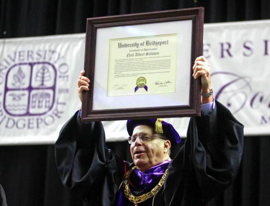 University of Bridgeport President Neil Salonen receives an Certificate of Appreciation during the school's 108th Commencement Ceremony at Webster Bank Arena in Bridgeport, Conn. on Saturday May. 5, 2018. This is President Salonen's final graduation before retiring. Photo: Christian Abraham / Hearst Connecticut Media / Connecticut Post