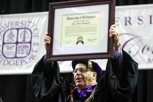 University of Bridgeport President Neil Salonen receives an Certificate of Appreciation during the school's 108th Commencement Ceremony at Webster Bank Arena in Bridgeport, Conn. on Saturday May. 5, 2018. This is President Salonen's final graduation before retiring.