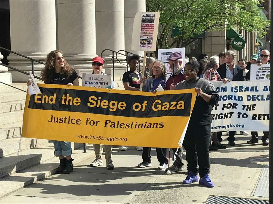 Protesters march down Church Street in New Haven Monday in an effort to call attention to the killings of Palestinian protesters by Israeli soldiers. Photo: Luther Turmelle / Hearst Connecticut Media