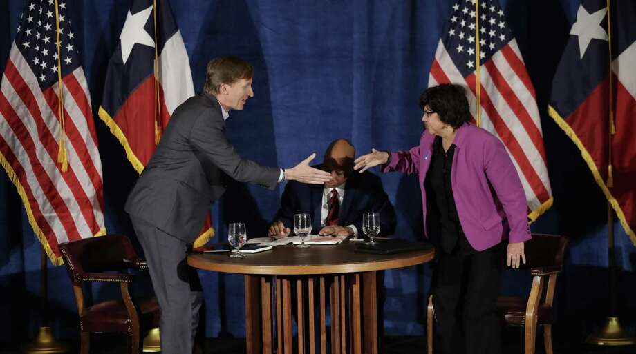 Texas Democratic gubernatorial candidates Andrew White, left, and Lupe Valdez, right, shake hands following their debate, Friday, May 11, 2018, in Austin, Texas, ahead of the state's May 22 primary runoff election. Moderator Gromer Jeffers is at center. (AP Photo/Eric Gay) Photo: Eric Gay, STF / Associated Press / Copyright 2018 The Associated Press. All rights reserved.