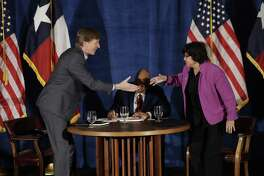 Texas Democratic gubernatorial candidates Andrew White, left, and Lupe Valdez, right, shake hands following their debate, Friday, May 11, 2018, in Austin, Texas, ahead of the state's May 22 primary runoff election. Moderator Gromer Jeffers is at center. (AP Photo/Eric Gay)