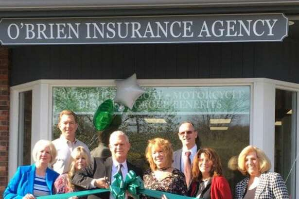 The O'Brien Insurance Agency, LLC in New Milford has opened a second office at 88 Route 37 in New Fairfield. Assisting Christopher and Amy O'Brien, center, with the ribbon-cutting ceremony to open the office are, from left, New Fairfield First Selectman Patricia Del Monaco; O'Brien Insurance agent Brian Peet, a resident of New Fairfield; Celeste Turner, personal lines CSR of New Milford; Bill Mitchell, agent and office manager; Brenda James-Arico, personal lines CSR of New Fairfield; and Kathy Frost, commercial CSR, of New Milford. Missing from the celebratory event were Anne Flynn, agent, of New Milford; Trisha Mitchell, a personal lines CSR, a resident of Naugatuck; and Laura Gustafson, receptionist, a resident of North Branford.