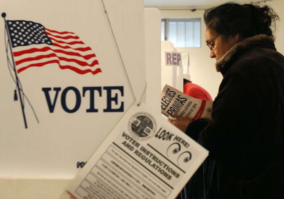 A woman reads voting instructions in Spanish at a polling station for the California primary elections in Los Angeles in 2008. Photo: LUCY NICHOLSON / REUTERS