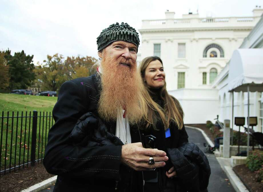 "In a rare public photo without his ""cheap sunglasses,"" ZZ Top guitarist and lead vocalist Billy Gibbons is shown with his wife Gilligan Stillwater during a tour of the White House in November 2017. Photo: Manuel Balce Ceneta / AP / Copyright 2017 The Associated Press. All rights reserved."