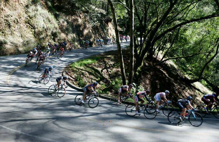 The pelaton speeds down Panoramic Highway through Muir Woods. Stage 1 of the 2007 Amgen Tour of California, a 650 mile bicycle race from San Francisco to Long Beach, California. Eighteen teams and 144 riders are participating in the 8 day race through California. Today's stage on February 19, 2007 started in Sausalito, went out to the coast and then inland finishing 97.2 miles later in Santa Rosa. Photo by Michael Maloney / San Francisco Chronicle