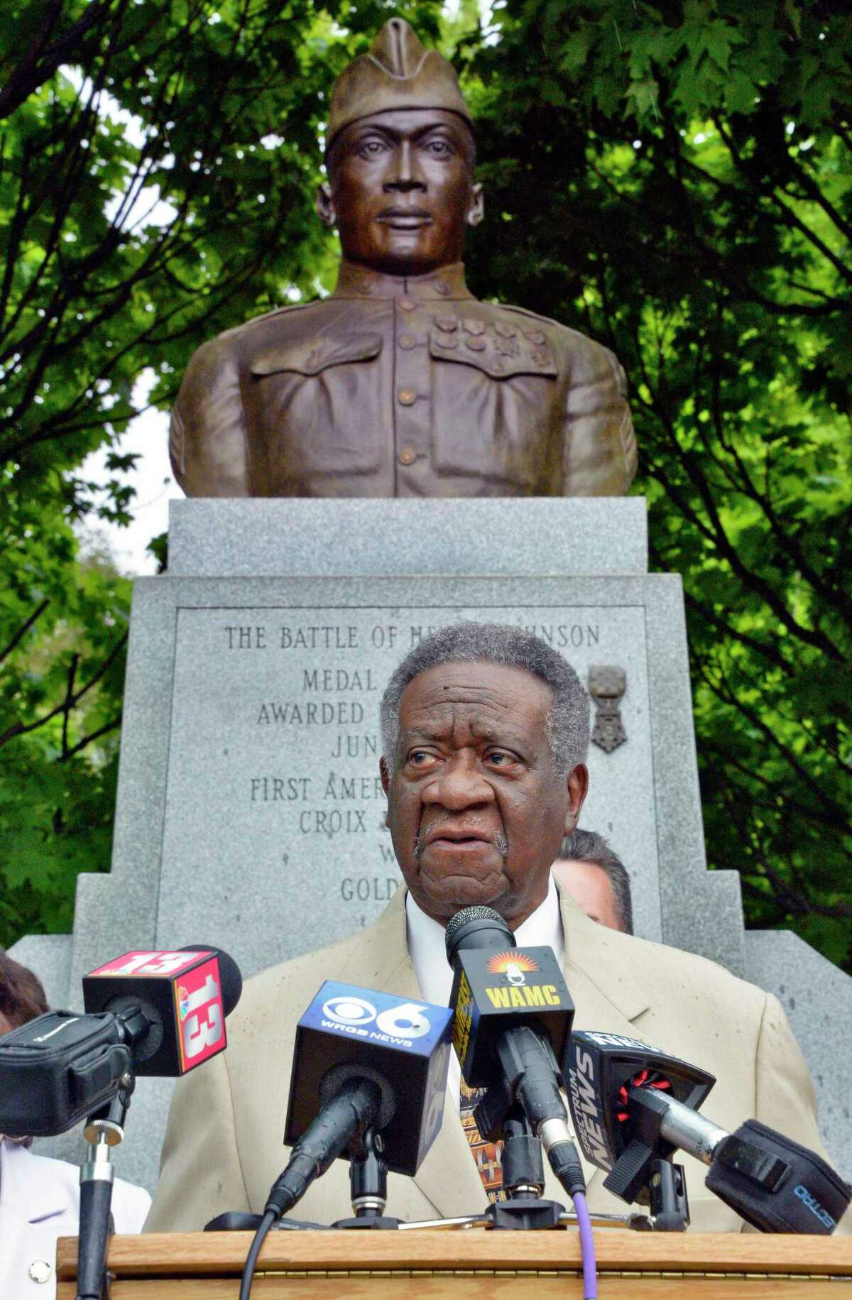 County legislator William Clay reads the Medal of Honor citation for Sgt. Henry Johnson on the 100th anniversary of Henry Johnson's defeat of nearly two dozen German soldiers, an act that won him the Medal of Honor during a ceremony in Washington Park Tuesday May 15, 2018 in Albany,NY. (John Carl D'Annibale/Times Union)