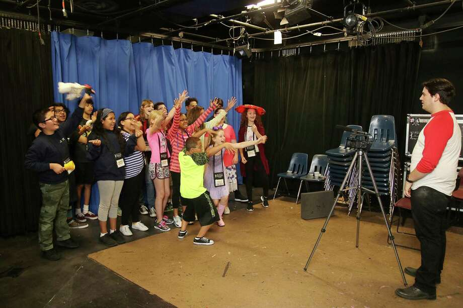 Youths participate in a summer musical theater camp at San Jacinto College Central. San Jac is offering a variety of camps for children this summer covering topics ranging from music to sports to science. Photo: Pin Lim, Freelance / For The Chronicle / THE JOURNALS
