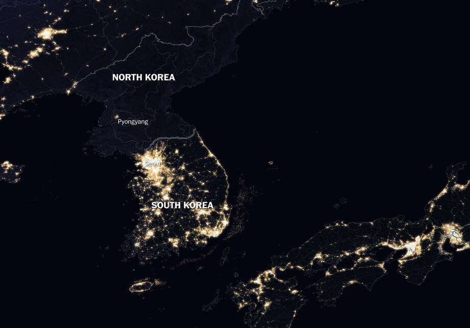 NASA view of the Korean Peninsula at night illustrates the relationship between nighttime lighting and economic activity: North Korea is almost entirely dark, while South Korea sparkles with light. Photo: NASA-The Washington Post / The Washington Post