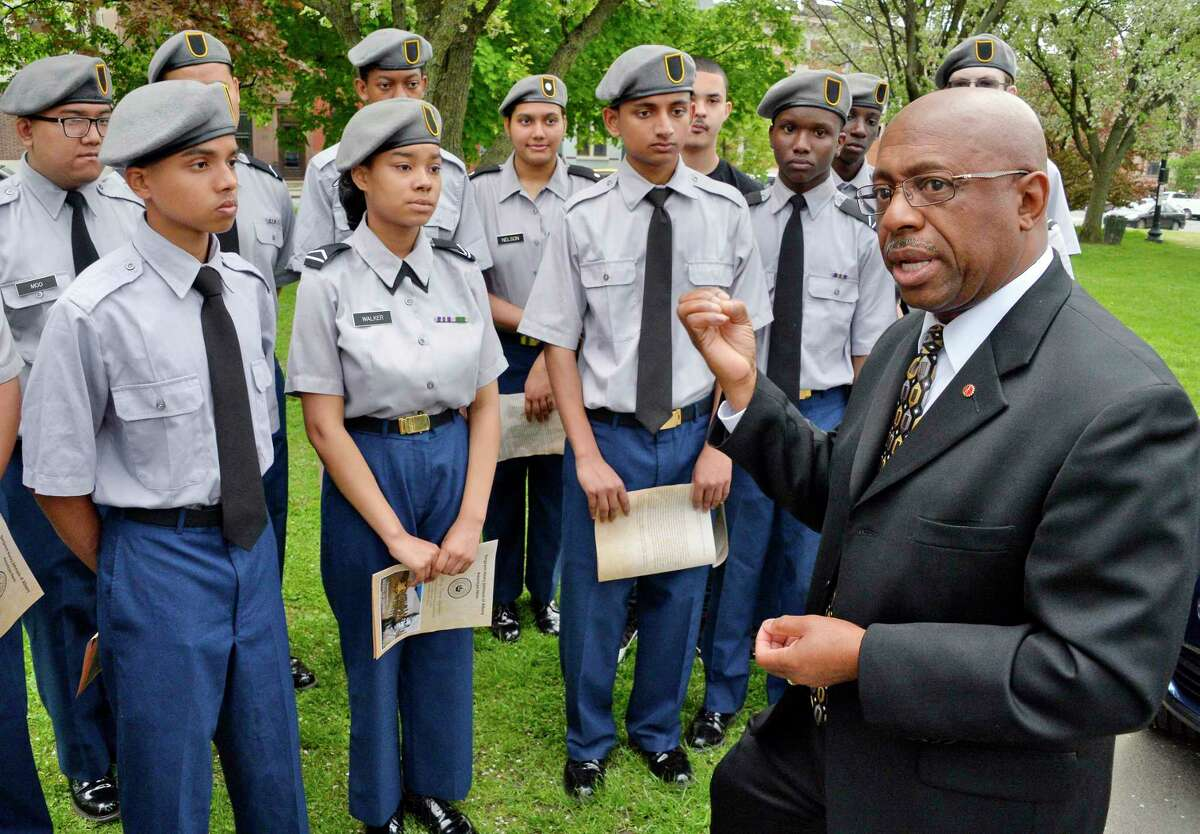 Command Sergeant Major Louis Wilson of the New York National Guard (ret.) speaks with members of the Sgt. Henry Johnson Battalion JROTC of Albany High School during the 100th anniversary of Henry Johnson's defeat of nearly two dozen German soldiers, an act that won him the Medal of Honor during a ceremony in Washington Park Tuesday May 15, 2018 in Albany,NY. (John Carl D'Annibale/Times Union)