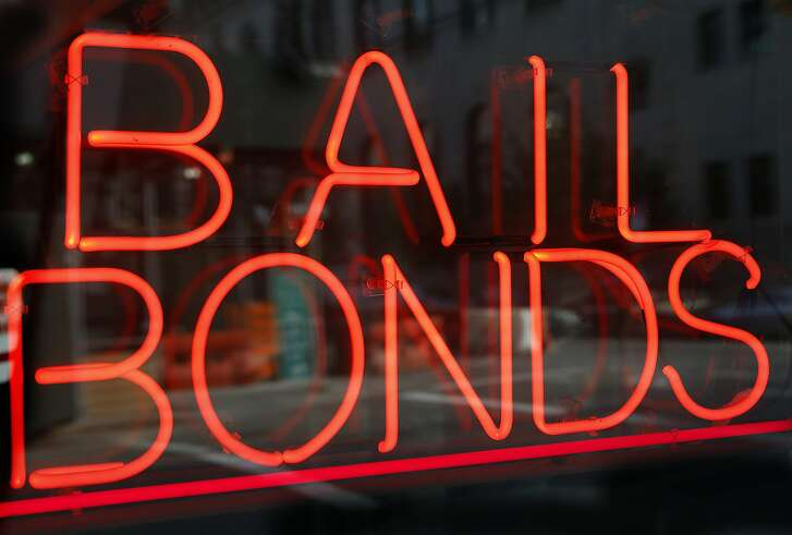 FILE - This July 7, 2015, file photo, shows a sign advertising a bail bonds business in the Brooklyn borough of New York. A new Texas nonprofit promoting crime victims' rights is opposing bipartisan efforts to end cash bail systems that have gained traction around the country - hitting back at one of the few issues that unified advocates on both the right and left. Kicking off Thursday, Feb. 15, 2018, the Texas Alliance for Safe Communities wants to strengthen public safety and curb violent crime. (AP Photo/Kathy Willens, File)