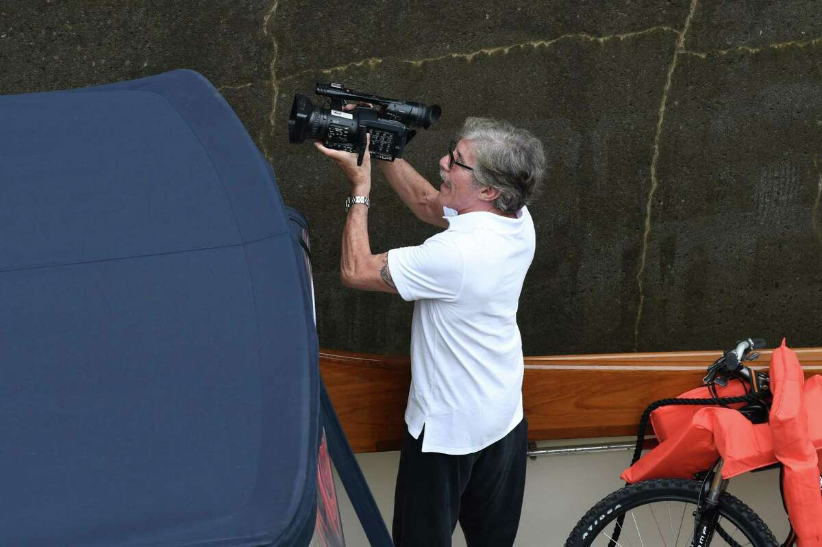 TV personality Geraldo Rivera films from inside Lock 2 where he was on one the first boats to begin the canal's navigation season on Tuesday, May 15, 2018, in Waterford, N.Y. Rivera was sailing from New York to Cleveland. (Will Waldron/Times Union)
