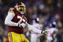 LANDOVER, MD - NOVEMBER 23: Offensive tackle Kevin Bowen #72 of the Washington Redskins reacts after sacking quarterback Eli Manning #10 of the New York Giants (not pictured) in the fourth quarter at FedExField on November 23, 2017 in Landover, Maryland. (Photo by Patrick McDermott/Getty Images)