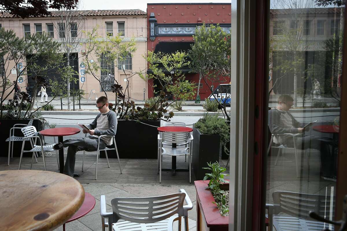 Matt Worden enjoys the outdoor space of the parklet outside of Mojo Bicycle Cafe on Divisadero Street on Tuesday, March 24, 2015.