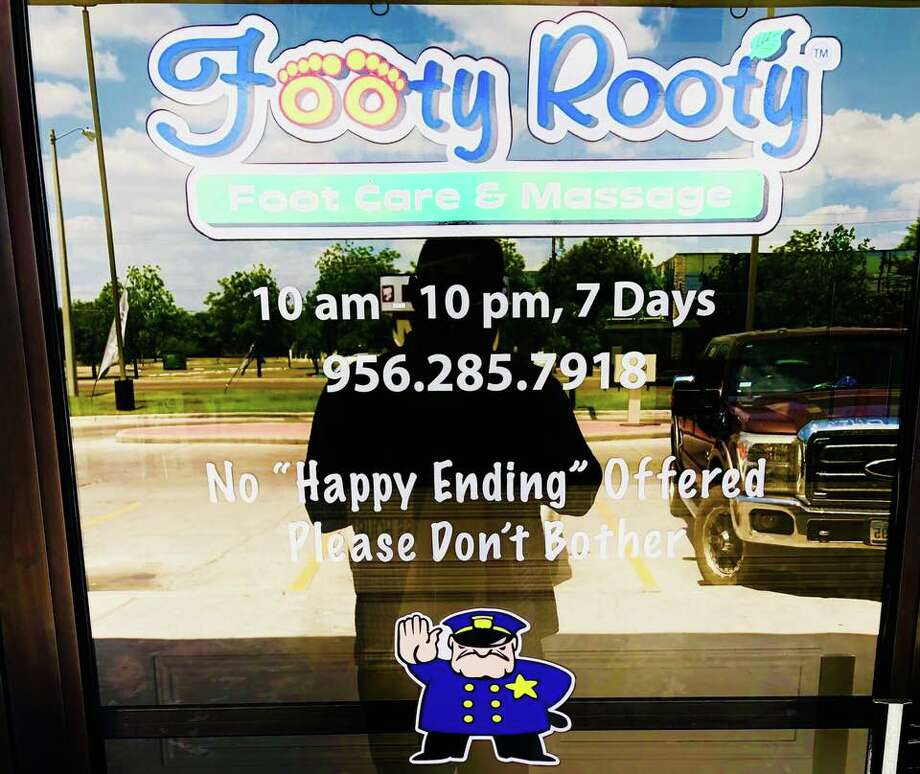 At the entrance of Laredo's Footy Rooty spa, customers will be greeted with this message. Photo: Courtesy