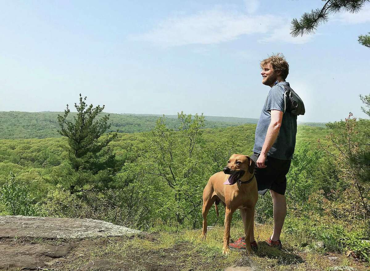 Ridgeback backpack founder Jon Espeland and his dog Kumba stand at a lookout area at Pine Mountain in Ridgefield, Conn., on Tuesday, May 15, 2018.