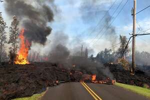 AFTER: In this handout photo provided by the U.S. Geological Survey, lava from a fissure slowly advances to the northeast on Hookapu Street after the eruption of Hawaii's Kilauea volcano on May 5, 2018 in the Leilani Estates subdivision near Pahoa, Hawaii.