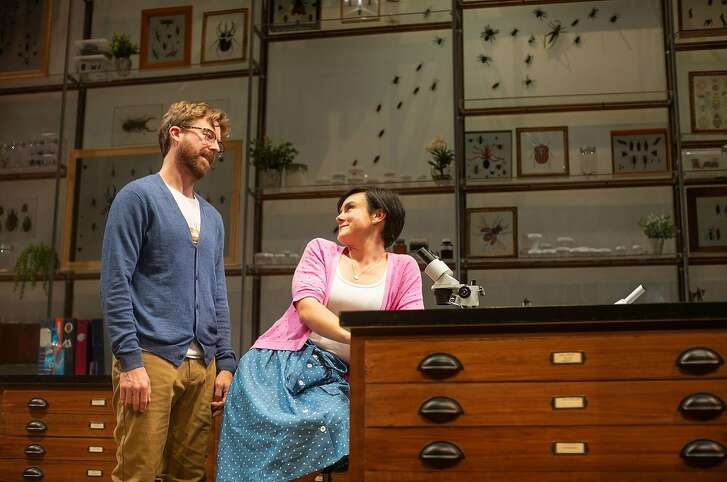 """Lindsay (Jessica Lynn Carrol, right) examines insects under Jeff�s (Lucas Verbrugghe) supervision in San Francisco Playhouse's """"An Entomologist's Love Story."""""""
