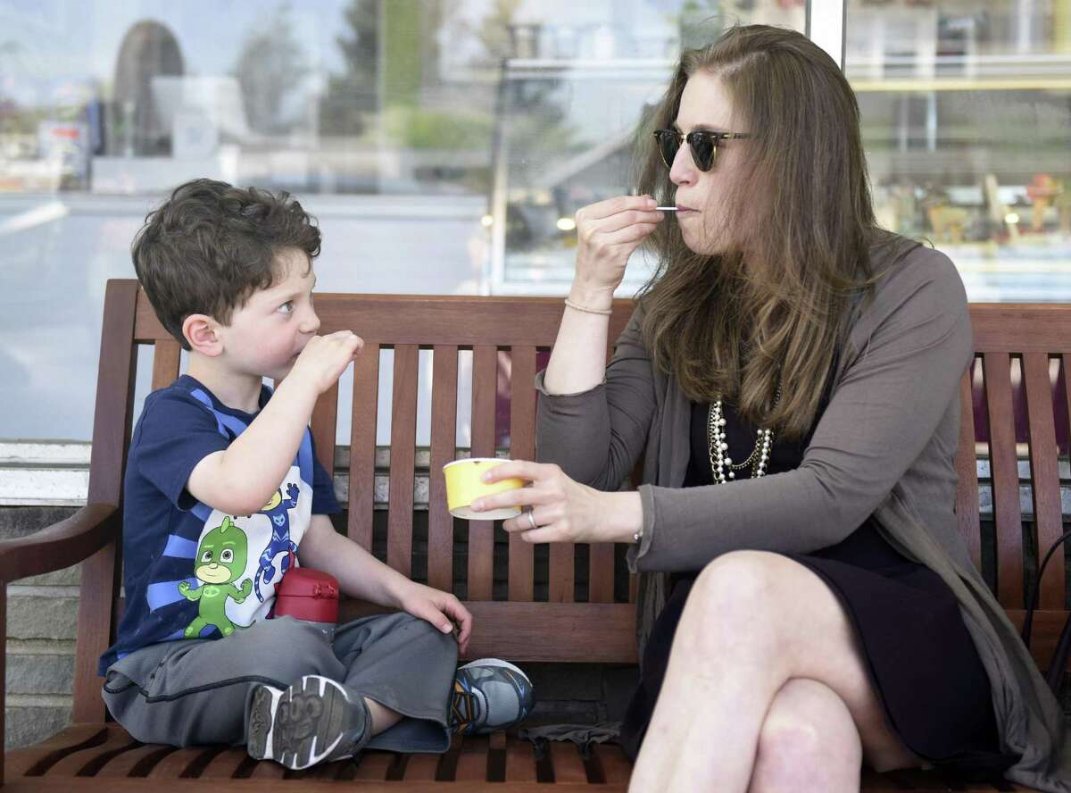 Greenwich resident Jessica Shapiro and her son, Asher, 3, enjoy gelato outside Gelato & Cioccolato in the Cos Cob section of Greenwich, Conn. Tuesday, May 8, 2018. The new shop offers original Italian gelato from a family recipe born in northeastern Italy near Venice.