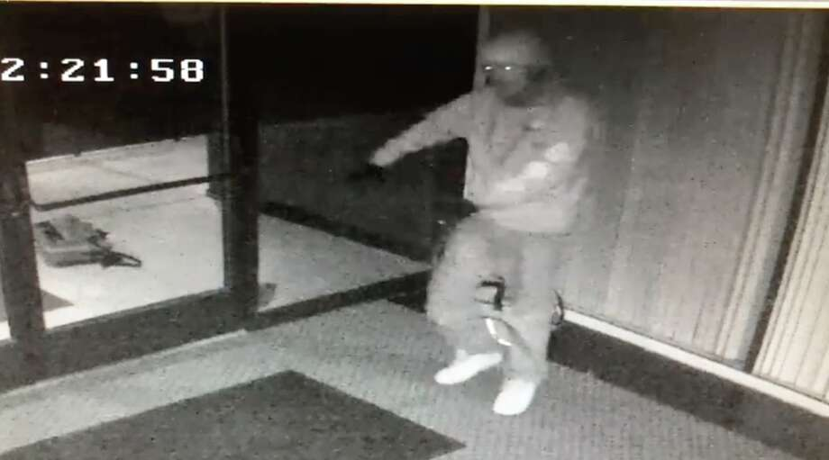 A screenshot shows the suspect dancing in the Fresno business's lobby.