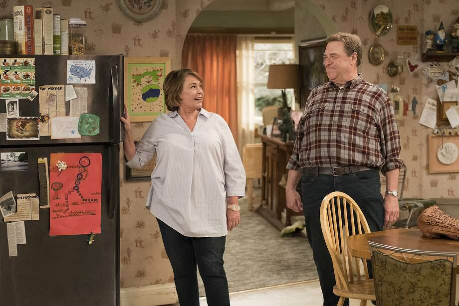 """This image released by ABC shows Roseanne Barr, left, and John Goodman in a scene from the comedy series """"Roseanne."""" Expect """"Roseanne"""" to cool it on politics and concentrate on family stories when it returns for the second season of its revival next year. ABC Entertainment chief Channing Dungey noted that as the first season went on, the focus shifted from politics to family. She said that direction will continue next season. (Adam Rose/ABC via AP) Photo: Adam Rose, Associated Press"""