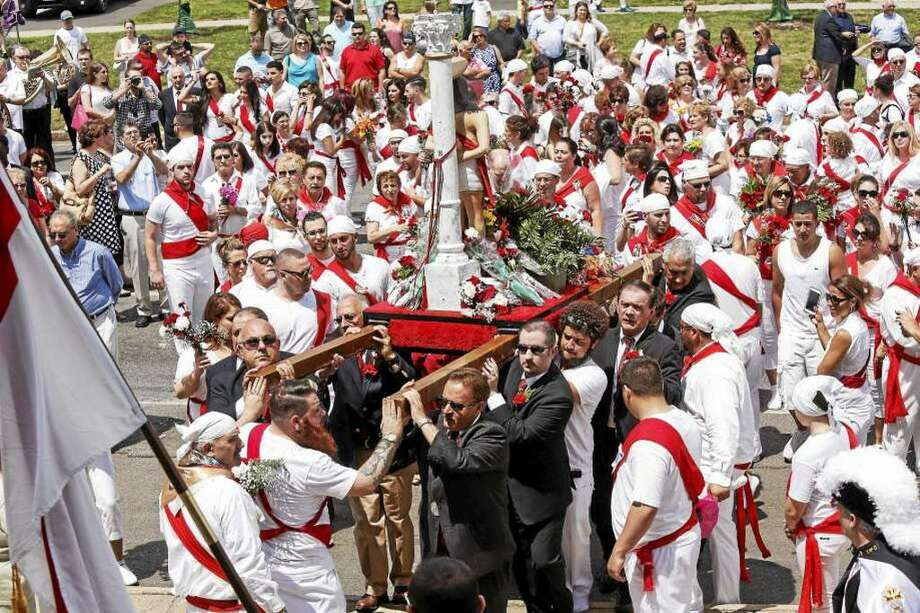On Sunday, participants, barefoot and dressed in white with red sashes and carrying carnations, make their way to the church from two locations: the cemetery on Route 66 in Middlefield and the Italian Society on Court Street. Photo: File Photo