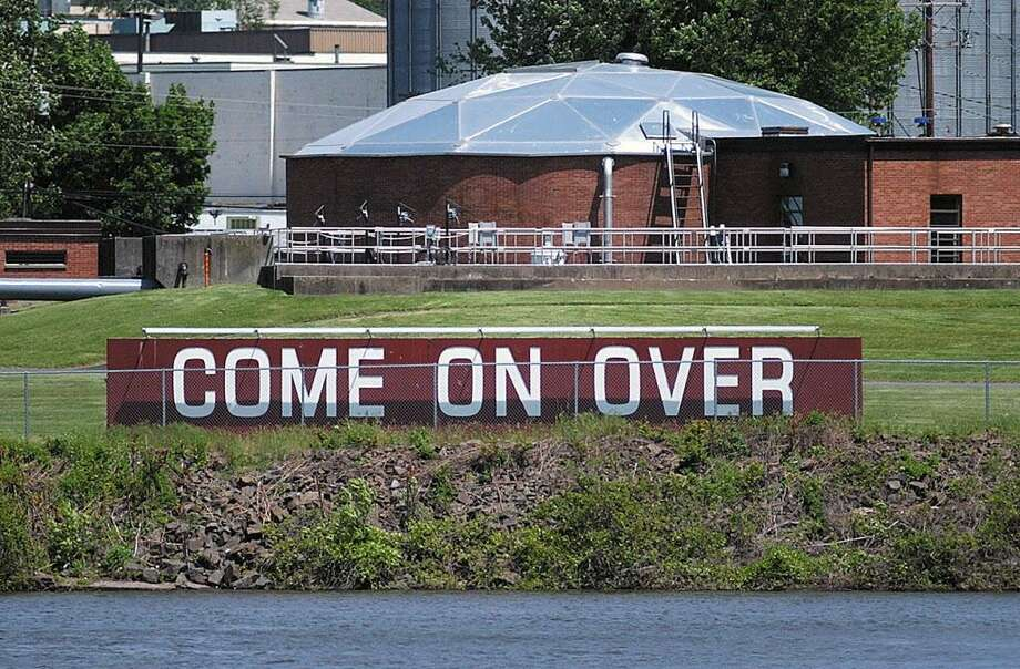 Portland's sign welcomes visitors across the Connecticut River. Photo: File Photo