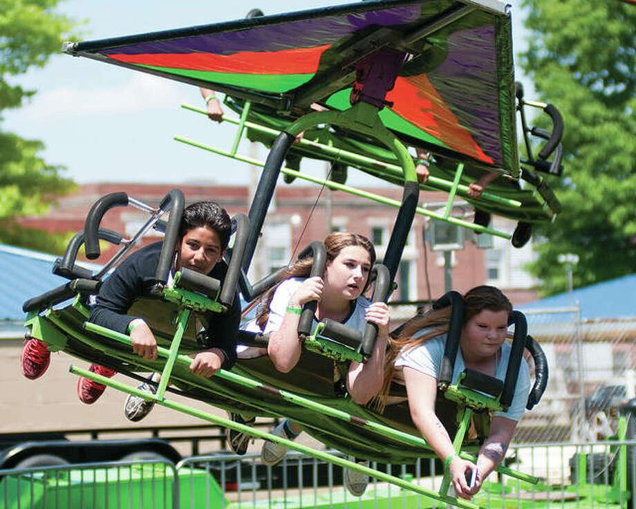 Bethalto Jaycees Country Fair patrons enjoy a ride at the 2016 fair. Photo:       Dan Cruz   For The Telegraph