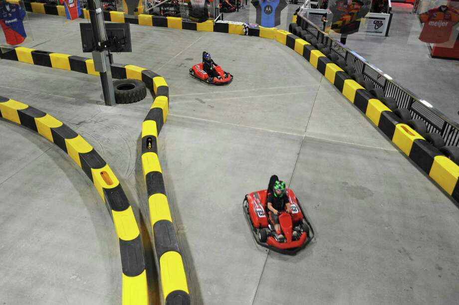 Nine-year-old Henry Wahl races around a corner as his sister Hannah Wahl attempts to catch up inside the new RPM Raceway go-karting track at 600 West Ave. in Stamford, Conn., on Thursday, May 10, 2018. Photo: Michael Cummo / Hearst Connecticut Media / Stamford Advocate