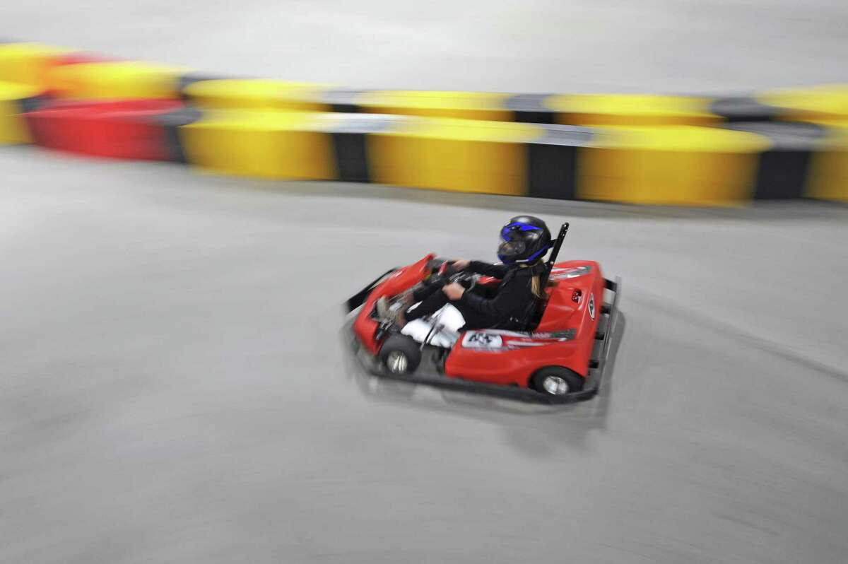 13-year-old Hannah Wahl zips down one of the two go-karting tracks inside the new RPM Raceway go-karting track on West Ave. in west Stamford, Conn. on Thursday, May 10, 2018.