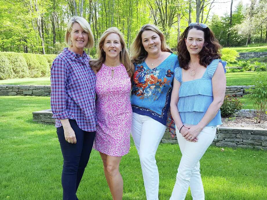 Laurie Crimmins, left, Tamara Kalin, Carrie Preisano and Elizabeth Walsh, the planning committee for the A Better Chance of Wilton garden party, stand in Kalin's garden where the June 3 fundraiser for the ABC program will take place. Photo: Contributed Photo / Contributed Photo / Norwalk Hour contributed