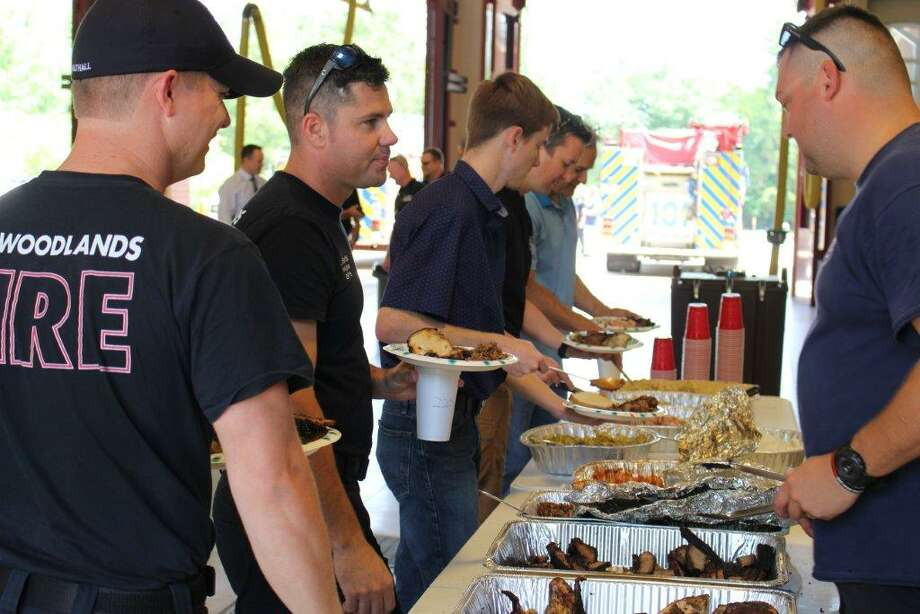 Dozens of Woodlands-based law enforcement met in honor of National Police Week at the Central Fire Station on Grogans Mill Road to mingle and get to know one another while enjoying smoked brisket, chicken and cold potato salad. Photo: Michelle Iracheta / The Woodlands Villager
