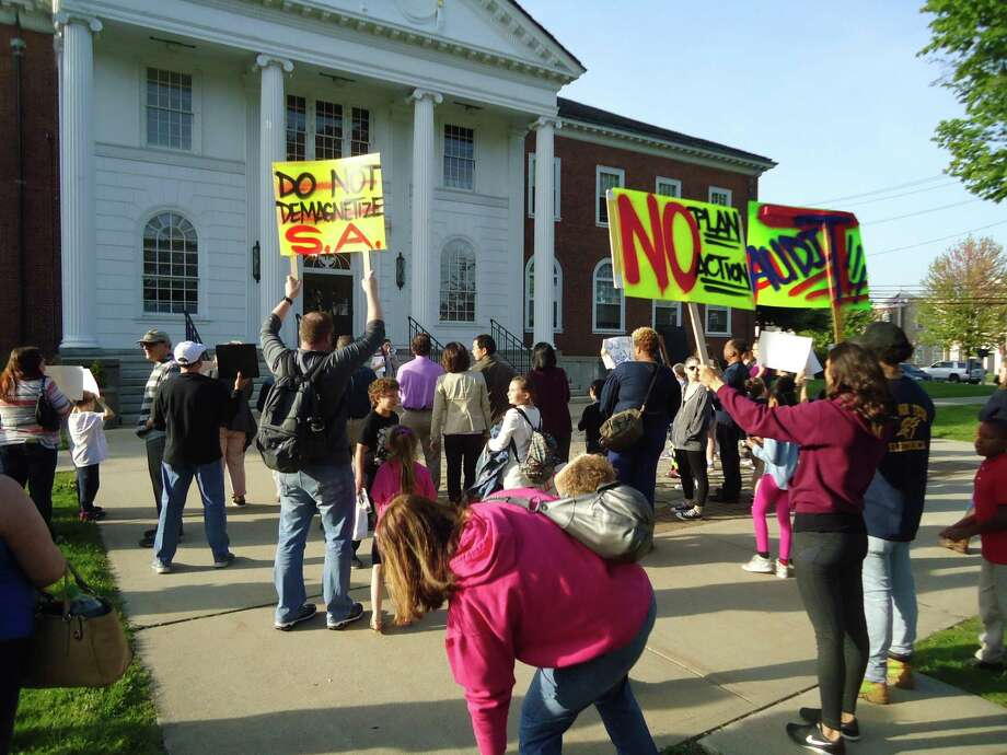 About 100 parents and children turned out to protest the Stratford Board of Education's move to end its magnet school program on Monday, May 14, 2018 in front of Town Hall.. Photo: John Burgeson / Hearst Connecticut Media