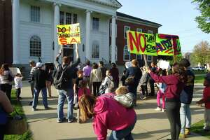 About 100 parents and children turned out to protest the Stratford Board of Education's move to end its magnet school program on Monday, May 14, 2018 in front of Town Hall..