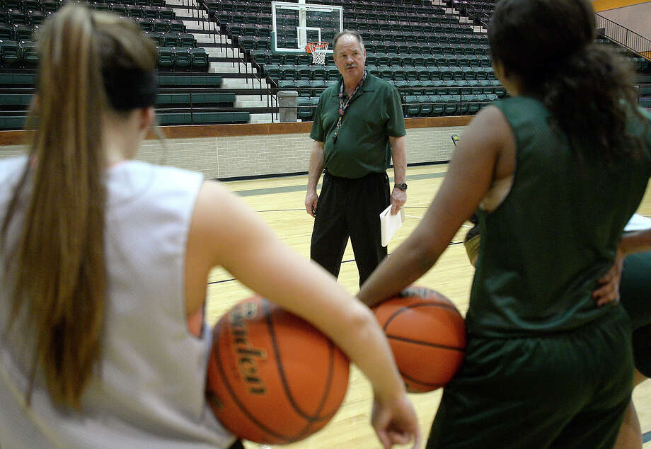 East Chambers head coach Eddie Michalko talks with his team before the start of practice after school Thursday. The girls won their district and first play-off game and are looking to advance.
