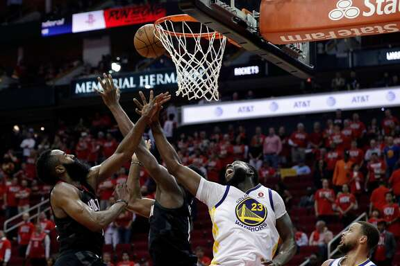 Draymond Green (23) defends against a shot by Chris Paul (3) in the second half as the Golden State Warriors played the Houston Rockets in Game 1 of the Western Conference Finals at Toyota Center in Houston, Texas., on Monday, May 14, 2018.