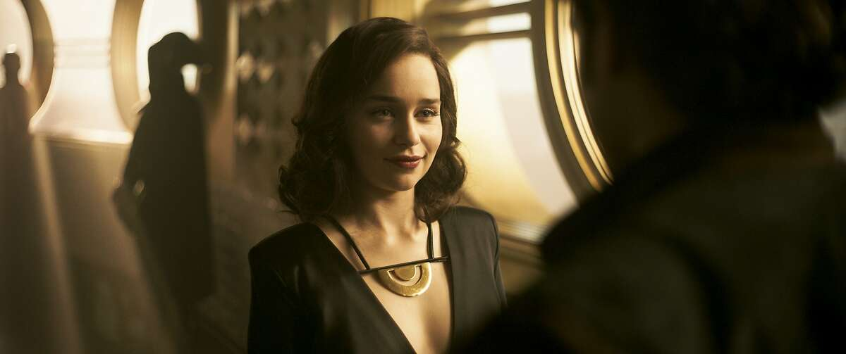 """This image released by Lucasfilm shows Emilia Clarke as Qi'ra in a scene from """"Solo: A Star Wars Story."""" (Lucasfilm via AP)"""