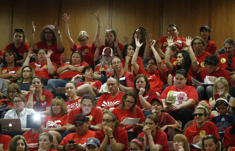 Teachers fill the gallery of the Arizona House of Representatives as budget talks continue on the floor during continued protests at the Arizona Capitol Thursday, May 3, 2018, in Phoenix. After an all night legislative budget session the legislature passed the new education spending portion of the budget and Republican Gov. Doug Ducey signed that part of the budget. Photo: Ross D. Franklin, STF / Associated Press / Copyright 2018 The Associated Press. All rights reserved.