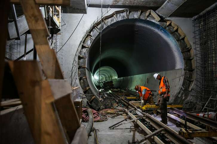 (l-r) Workers David Lopez and William Butler do construction on the central subway in the Moscone station in San Francisco, Calif., on Wednesday, Sept. 13, 2017.